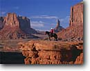 Stock photo. Caption: Navajo horseman and Mitten Buttes Monument Valley   Navajo Tribal Park Navajo Nation,   Arizona -- united states america wisdom proud canyons landscape majestic red rock country landscapes vista view views vistas sunny parks overlooks grand classic horse animal animals horses rider horseback western icon native american movie riding pride cowboy