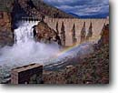 Stock photo. Caption: Theodore Roosevelt Dam Salt River along the Apache Trail Sonoran Desert Arizona -- flood floods rainbow rainbows crashing dams rivers spillway spillways southwest southwestern power powerful rushing water hydro hydroelectric production energy electricity power powerhouse powerhouses generator generators generation