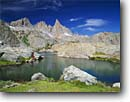 Stock photo. Caption: Fishing below the Ritter Range Ansel Adams Wilderness Inyo National Forest Sierra Nevada,  California -- Keywords: united states america hiker hiking backpack backpacking backpacker landscape landscapes adventure solitude fisherman highcountry lake lakes mountains wildernesses sierras backcountry fish trout leisure people john muir trail pacific crest angler anglers a