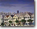 Stock photo. Caption: Victorians at Alamo Square   and the downtown skyline San Francisco Bay Area,  California -- united states america landscape landscapes west pacific san Francisco  skyline icon icons famous bays skylines city cities cityscape cityscapes victorian houses house building buildings rows vintage sameness same similar alike home homes flat flats