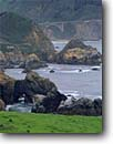 Stock photo. Caption: Rocky Creek Bridge Pacific Coast Highway 1 Big Sur Coast Monterey County, California -- one seascape seascapes seastack seastacks headland headlands united states america surf scene scenic scenics historic historical arch sea arches highway highways freedom transportation backroads spring bridges