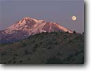 Stock photo. Caption: Moonrise over Mt. Shasta   from Shasta Valley Siskiyou County Cascade Range, California -- united states america peak peaks snow capped summer mountain mountains volcano volcanos volcanoes inactive moonrises moon moons