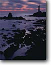 Stock photo. Caption: Winter sunset Pigeon Point Lighthouse   at dusk San Mateo County California -- light station stations lighthouses pacific ocean coast sunsets surf waves coastal shoreline shorelines united states america protection beacon beacons direction guidance pharos navigation navigational aid aids seastacks dusk