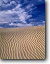 Stock photo. Caption: Mesquite Flat Dunes Death Valley National Park Mojave Desert California -- mohave sand dune ripple ripples deserts parks winter ethereal landscape landscapes united states america tourist travel destination destinations patterns artistic nature transitory shifting solitude soft calming sky skies spring geology