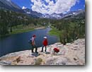 Stock photo. Caption: Hiking in Little Lakes Valley    Long Lake,  John Muir Wilderness Inyo National Forest,  Sierra Nevada Inyo County,  California -- Keywords: united states america backpack hikers hike backpacker landscape landscapes adventure solitude highcountry lake lakes mountains wildernesses sierras backcountry isolation isolated peace peaceful people summer