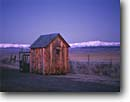 Stock photo. Caption: Holiday outhouse in Long Valley   and the White Mountains     in Inyo National Forest Eastern Sierra Nevada, California -- united states america  peace peaceful Christmas lights light outhouses toilet toilets latrine festive mountains snow covered sierras cute symbol western rest room john privy head rustic head