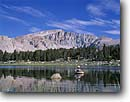 Stock photo. Caption: Fly fishing,  Cottonwood Lakes John Muir Wilderness Inyo National Forest Sierra Nevada, California -- Keywords: united states solitude fisherman mountains sierras fish trout leisure flyfishing flyfisherman casting cast flycasting people float tube floattube floating lake wilderness america angler anglers angling