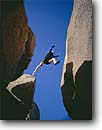 Stock photo. Caption: Bouldering in the Buttermilks Inyo National Forest Sierra Nevada California -- Keywords: united states people person climb climbing challenge climbers challenging blue skies america  mountain excitement action sport sports extreme outdoor recreation climber activity leap leaping jump jumping fearless faith sierras brave summer strength rock