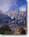 Stock photo. Caption: Bouldering in the Buttermilks Inyo National Forest Sierra Nevada California -- Keywords: united states people person climb climbing challenge challenges challenging america mountain excitement action sport sports extreme outdoor recreation climber activity leap leaping jump jumping fearless faith brave summer strength rock climbers mountains