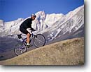 Stock photo. Caption: Mountain biking in the Buttermilks   below Mt. Humphreys Owens Valley, Inyo National Forest Sierra Nevada,   California -- Keywords: united states america people outdoor recreation biker bicycle bicycles trail trails bike transportation cross country crosscountry extreme freedom solitude excitement