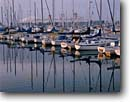 Stock photo. Caption: Downtown Shoreline Marina   and the Queen Mary Long Beach California --   marinas harbor harbors harbour harbours sailboat sailboats pleasure craft reflection reflections ship ships cruise morining light tourist destination destinations united states america pacific attraction attractions urban southern