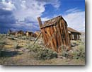 Stock photo. Caption: Leaning outhouse at Bodie  Bodie State Historic Park Mono County  Eastern Sierra, California -- united states america outhouses toilet toilets latrine mountains sierras cute symbol western rest room john privy head ghost town rustic