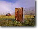 Stock photo. Caption: Wires keep this outhouse   from rock