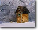 Stock photo. Caption: Outhouse in the   Eastern Sierra Nevada Mono County California -- united states america outhouses toilet toilets latrine mountains sierras cute symbol western rest room john privy head rustic cold snow shingled shingles winter
