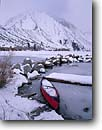 Stock photo. Caption: Canoe on Convict Lake and Mt. Morrison Inyo National Forest Eastern Sierra Nevada, California -- united states america mountains sierras western snow winter canoes boat boats wintery snowy boating end of season seasonal cold