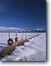 Stock photo. Caption: Holiday decorations on fence Owens River Valley   near Lake Crowley Sierra Nevada,  California -- united states america mountains sierras western ranching ranch snow winter christmas christmasy wreaths wreath bows seasonal cheer holidays