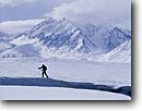 Stock photo. Caption: Skier, Eastern Sierra Nevada peaks   from Long Valley   next to the Owens River Mono County, California -- Keywords: united states america high mountain  high country sierras backcountry people highcountry cross country skier skiing winter snow covered snowy crosscountry outdoor recreation sport sports landscapes landscape scenics scenic views