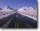 Stock photo. Caption: Convict Lake Road    and Mt. Morrison Inyo National Forest Sierra Nevada, California -- united states america landscape landscapes mountains sierras snow winter roads covered icey frosty travel transportation melting freezing cold blue sky skies