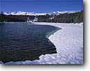 Stock photo. Caption: Twin Lakes, Crystal Crag   and the Mammoth Crest Inyo National Forest Sierra Nevada,  California -- united states america landscape landscapes solitude highcountry lake lakes mountains sierras winter snow covered forests shore shoreline frozen melting icey