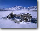 Stock photo. Caption: Old wagon in winter Round Valley Sierra Nevada Inyo County,  California -- united states america mountains sierras western ranching ranch snow winter wagons americana wheels wheel cart nostalgia