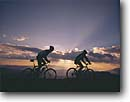 Stock photo. Caption: Mountain biking on    San Joaquin Ridge Inyo National Forest Sierra Nevada, California -- Keywords: united states america people outdoor recreation biker bicycle bicycles trail trails bike transportation cross country crosscountry freedom solitude excitement bikes cyclist cycler cyclers silhouette silhouettes sport sports landscape landscapes scenics