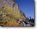 Stock photo. Caption: Devils Postpile in autumn Devils Postpile National Monument Eastern Sierra Nevada Mono County,  California -- united states america sierras landscape landscapes rock rocky forests west autumn columnar basalt formation monumnets sunny blue sky skies unusual geology geologic attraction attractions tourist family vacation destination destinations landmark landmarks