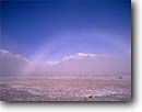 Stock photo. Caption: Fog bow and McGee Mountain Long Valley Eastern Sierra Nevada Mono County, California -- Keywords: united states america sierras landscape landscapes blue sky skies clear sunny eastside rainbow rainbows unusual weather phenomena snow covered peaks peak winter