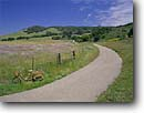 Stock photo. Caption: Country road Gaviota Santa Barbara County California -- united states america buildings central valley bicycle bicycles roads scenic drives drive inviting pastoral people byway byways coast range