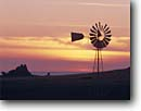 Stock photo. Caption: Windmill Cayucos Point San Luis Obispo County California -- windmills cattle tanks grasslands united states america spring pumping rural ranch ranches ranchland ranchlands coastal nostalgic nostalgia aero americana