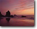 Stock photo. Caption: Trinidad State Beach Trinidad Humboldt County California -- beaches parks seastacks pacific ocean coast sunset sunsets united states america seastack west coasts seascape seascapes travel tourist destination destinations golden light shoreline shorelines coastal