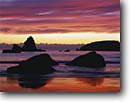 Stock photo. Caption: Trinidad Head   from Houda Point Beach Trinidad Humboldt County, California -- sunset sunsets beachs heads seastack seastacks cloud clouds surf waves pacific ocean coast oceans united states america seascape seascapes travel tourist destination destinations west coastal scenics pastels