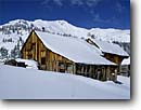 Stock photo. Caption: Mining Camp Red Mountain Pass San Juan Mountains Colorado -- united states america historic historical mine mines gold rushes rush mountain building buildings americana  mineral ore extraction past old west nostalgia nostalgic winter wintery snow covered snowy crisp clear