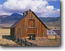 Stock photo. Caption: Two ranchers meet at the barn Crested Butte Rocky Mountains Colorado -- united states america landscape landscapes person people cowboys barns ranching ranch corral corrals