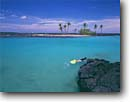 Stock photo. Caption: Kiholo Bay North Kona Island of Hawaii Hawaii -- united states america tropical hawaiian warm travel family snorkleing snorkling snorkle  bays  blue palm trees tree calm water destinations destination holiday people snorkel