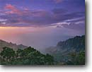Stock photo. Caption: Kalalau Valley and Na Pali Coast   from Kalalau Lookout Kokee State Park Island of Kauai,  Hawaii -- united states america tropical hawaiian warm travel family destinations destination holiday parks hiking dramatic sunset remote valleys rugged