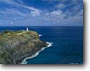 Stock photo. Caption: Kilauea Lighthouse Kilauea Point National Wildlife Refuge Island of Kauai Hawaii -- landscape landscapes coasts coastlines winter ocean oceans sunny blue skies clear scenics scenic lighthouses station light house building landmark landmarks attraction attractions hawaiian tropics tropical remote guidance isolation isolated rugged islands