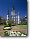 Stock photo. Caption: St. Louis Cathedral   from Jackson Square French Quarter New Orleans, Louisiana -- city cities sunny clear historic historical scenic destination destinations landmark landmarks attractions district districts spring warm scenics buildings building church churches cathedrals plaza squares catholic architecture flowers faith spiritual