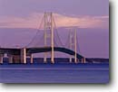 Stock photo. Caption: Mackinac Bridge Straits of Mackinac Lake Michigan St. Ignace, Michigan -- suspension bridges dawn night nightime county highway highways upper peninsula great lakes united states america transportation