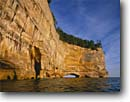 Stock photo. Caption: Grand Portal Point Lake Superior Pictured Rocks National Lakeshore Upper Peninsula, Michigan -- kayak kayaking arch arches national lakeshores summer great lakes united states outdoor recreation america challenge landscape landscapes canoeing area areas imposing vertical cliff cliffs peninsulas