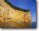 Stock photo. Caption: Grand Portal Point Lake Superior Pictured Rocks  National Lakeshore Upper Peninsula, Michigan -- kayak kayaking arch arches national lakeshores summer great lakes united states outdoor recreation america challenge people kayaker kayaks paddle paddles cliff cliffs imposing water sport sports lake sunny clear areas area