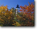 Stock photo. Caption: Red maples and Point Iroquois Light Lake Superior Hiawatha National Forest Upper Peninsula,  Michigan -- united states america lighthouse lights historic lighthouses great lakes protection beacon beacons direction guidance pharos navigation  navigational aid aids midwest midwestern hidden maple tree trees