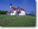 Stock photo. Caption: Point Iroquois Lighthouse Lake Superior Hiawatha National Forest Upper Peninsula, Michigan -- light lights station stations lighthouses lakes parks great lakes region united states america beacon beacons direction guidance navigation  midwestern midwest summer white clear sunny blue sky skies building buildings historic landscape landscapes