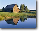 Stock photo. Caption: Old barn near Moose Lake Blacklock Nature Sanctuary Pine County,  Minnesota -- sanctuaries barns water reflection reflections early american pond ponds antique nostalgia americana vintage wooden rural midwest farm farming united states america rural pastoral summer building buildings blue sky skies clear sunny calm perfect