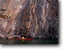 Stock photo. Caption: Kayaking on Lake Superior   beneath cliffs at Beaver Bay Lake County Minnesota -- united states america outdoor midwest red kayak boat america vacation north shore recreation great lakes solitude boating kayaks people summer kayaker kayakers paddling paddler water sports sport