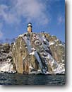 Stock photo. Caption: Split Rock Lighthouse   from Lake Superior Split Rock Lighthouse   State Historical Site,  Minnesota -- light lights station stations lighthouses parks great lakes region  american designated sites direction guidance navigation navigational aids midwestern midwest snow covered snowy solid permanent secure winter building buildings imposing clear snowcovered