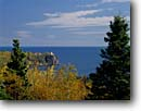 Stock photo. Caption: Split Rock Lighthouse Lake Superior Split Rock Lighthouse State Park Minnesota -- light lights station stations lighthouses lakes parks great lakes region united states america beacon beacons direction guidance navigation  midwestern midwest solid permanent secure parks autumn fall historic site sites designated landscape landscapes