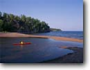 Stock photo. Caption: Kayaking Lake Superior mouth of Gooseberry River Gooseberry Falls State Park Minnesota -- united states america outdoor midwest red kayak boat america vacation north shore recreation great lakes solitude boating kayaks people summer kayaker kayakers paddling paddler water sports sport boats shoreline activity parks