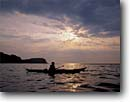 Stock photo. Caption: Kayaking at sunrise Lake Superior Split Rock Lighthouse State Park Minnesota -- united states america outdoor midwest red kayak boat america vacation north shore recreation great lakes solitude boating kayaks freedom people kayaker kayakers paddling paddler water sports sport activity freedom serene parks landscapes landscapes