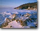 Stock photo. Caption: Winter ice in mid-morning sun Little Marais Township North Shore of Lake Superior Minnesota -- united states america midwest midwestern upper peninsula great lakes snow frozen freezing wintery cold winter freeze freezing lakeshores eerie ethereal blocks breakup light extreme bitter northern plates very clear sunny skies blue landscapes landscape