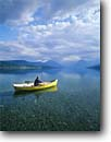 Stock photo. Caption: Rowboat Lake McDonald Glacier National Park Rocky Mountians, Montana -- united states america landscape landscapes adventure mountains rockies leisure canoe canoeing boat boating lakes canoes outdoor recreation water sport sports independence freedom travel rowboats people